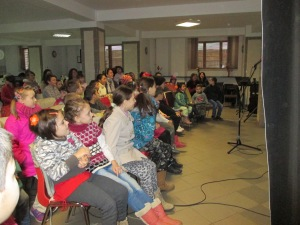 The first Saturday program held at the church, there were 50 kids!  Here they are listening to the story of Lazarus presented as a skit.